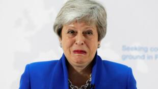 Theresa May grimace lors d'un discours, le 21 mai 2019.