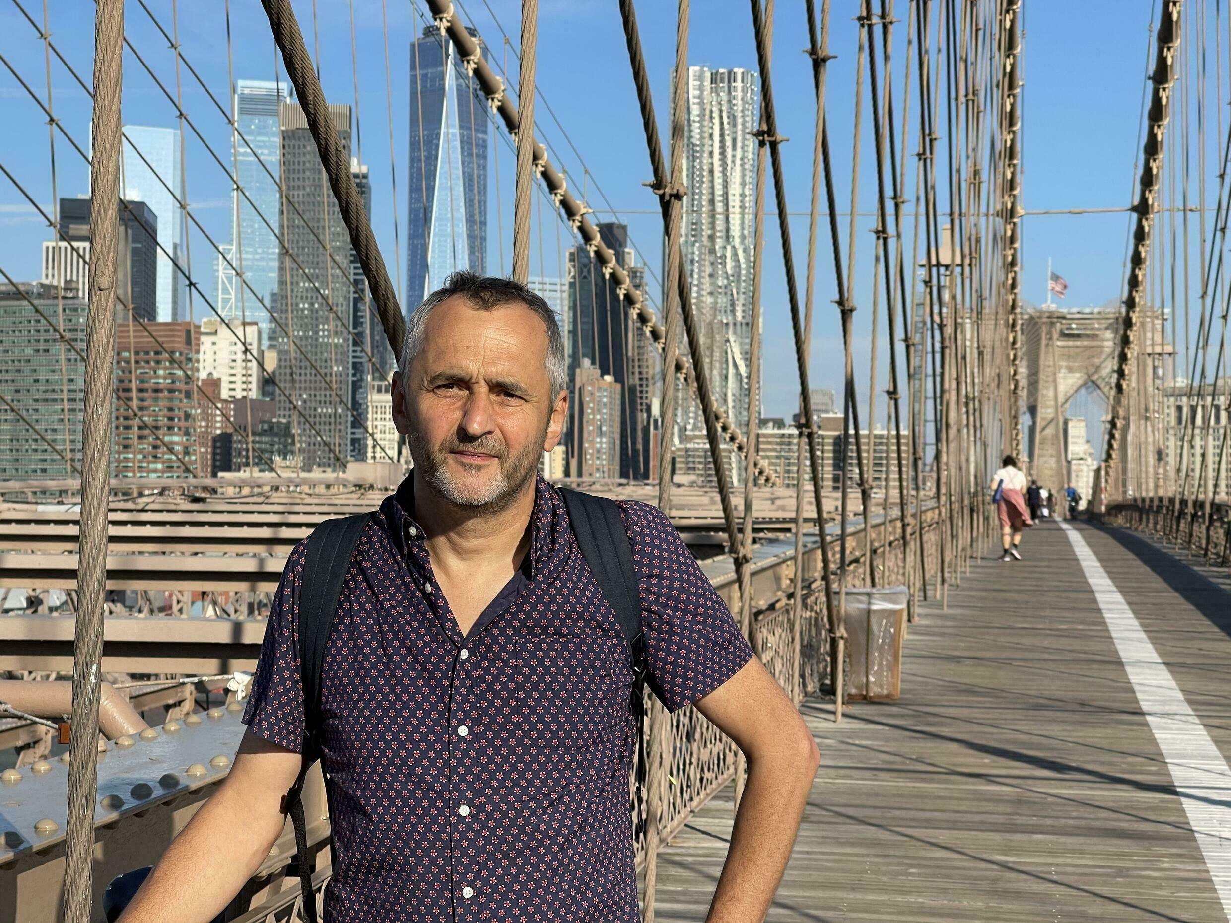 """""""New York became American that day,"""" says French-born Laurent Auffret, who was among those to flee across the Brooklyn Bridge on 9/11."""