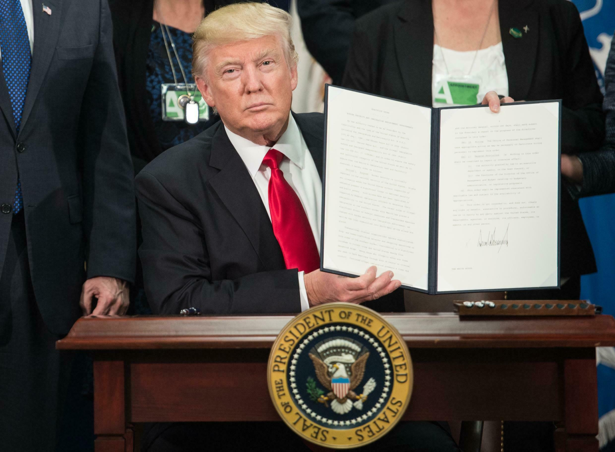 President Donald Trump signing the executive order to launch the proposed wall along the US-Mexico border January 25, 2017 in Washington.