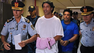 Ronaldinho and his brother Roberto Assis were escorted by police to a hearing on March 7
