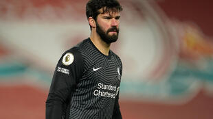Cold feet: Alisson Becker made to mistakes leading to Manchester City goals in Liverpool's 4-1 defeat on Sunday