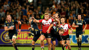 Jacques van Rooyen (C) leads the chase to secure possession while playing for the Golden Lions against the Otago Highlanders in Super Rugby