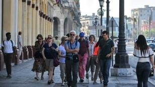 Foreign tourists walk along a street of Old Havana in May -- the administration of US President Donald Trump has eliminated the main avenue for Americans to visit the island