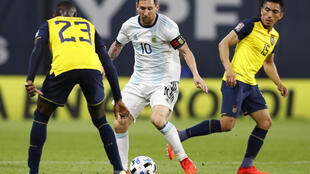Superstar Lionel Messi (center) made no mistake from the penalty spot to fire Argentina to an opening World Cup qualifying victory over Ecuador