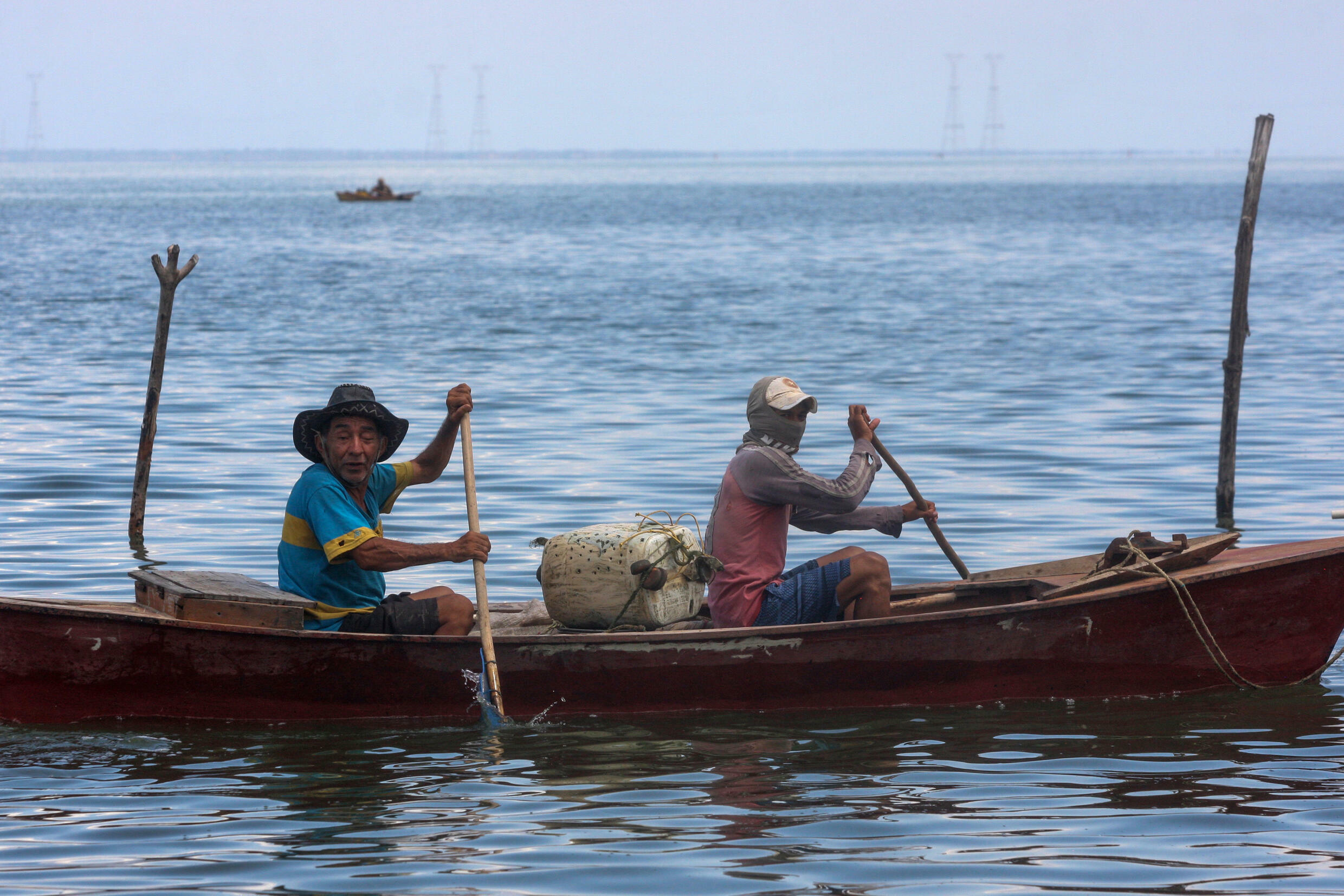 Fishermen in Lake Maracaibo often have to row their boats due to fuel shortages