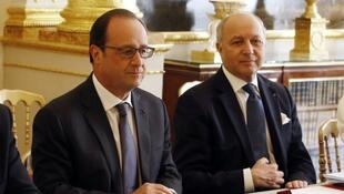 French President François Hollande and Foreign Minister Laurent Fabius at a Defence Council meeting convened at the Élysée Palace on June 24 following the WikiLeaks revelations.