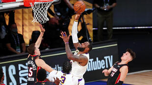 Los Angeles Lakers forward LeBron James (23) shoots in front of Miami Heat guard Duncan Robinson (55) during the third quarter in game six of the 2020 NBA Finals at AdventHealth Arena in Lake Buena Vista, Florida, on October 11, 2020.