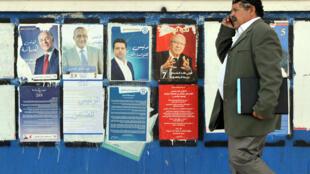 Affiches de campagne dans les rues de Tunis, le 20 novembre 2014.