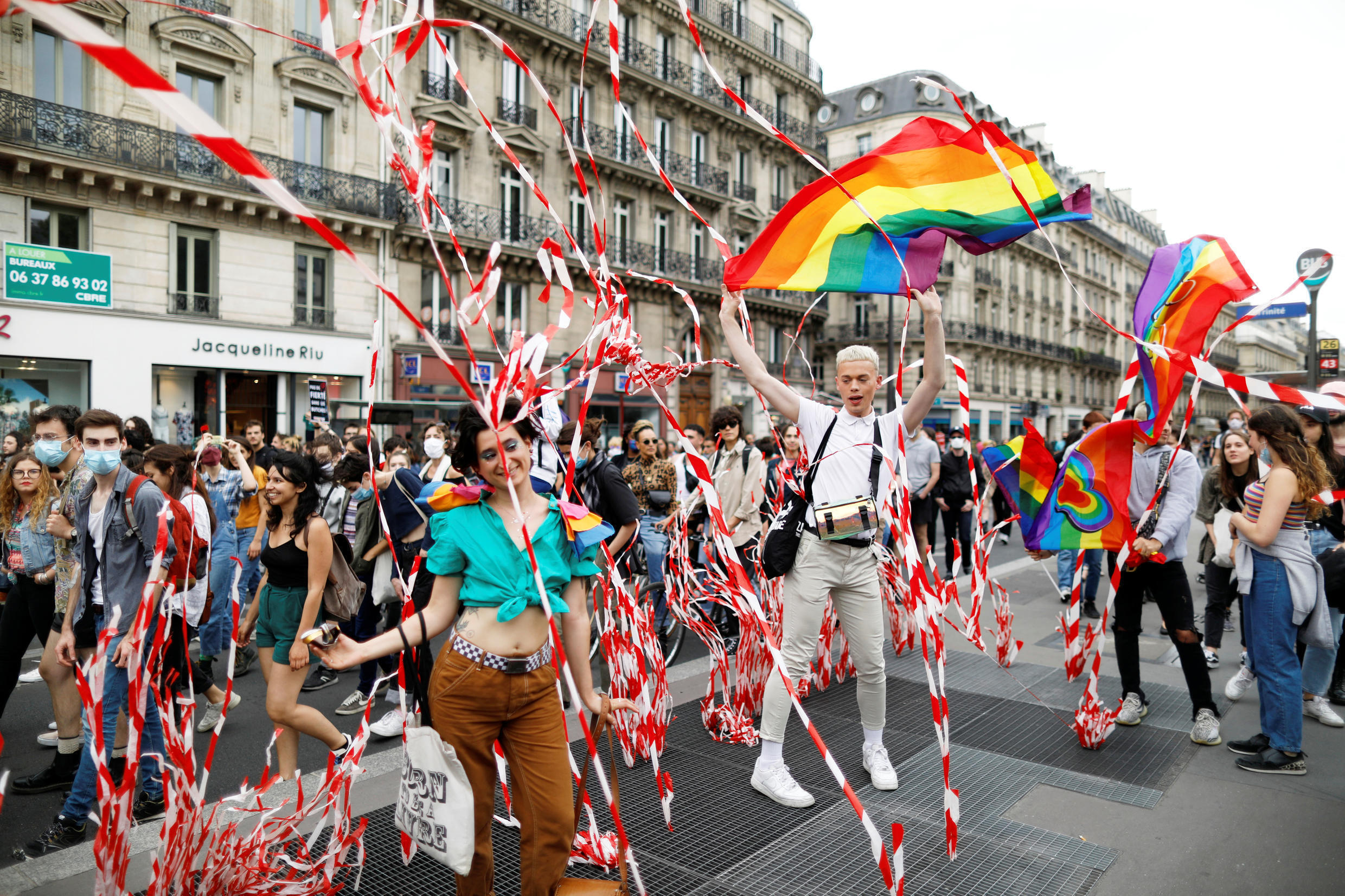 People attend an LGBT rights march despite social distancing restrictions forbidding gatherings of more than 10 people in Paris, France on July 4, 2020.