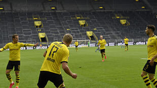 Erling Braut Haaland keeps his distance after opening the scoring in Borussia Dortmund's 4-0 win over local rivals Schalke