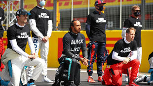 Lewis Hamilton and other Formula One drivers take a knee before the British Grand Prix