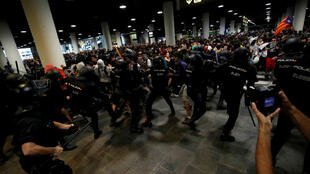 Clashes broke out between police and protesters at Barcelona's international airport on Monday.