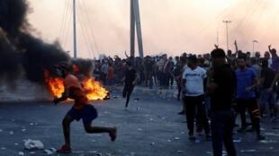 احتجاجات تلت رفع حظر التجوال في العراق. بغداد 5 أكتوبر/تشرين الأول 2019.