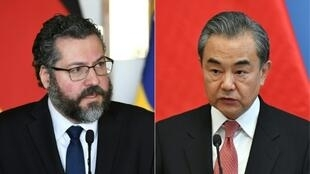 Brazilian Foreign Minister Ernesto Araujo (L) is likely to adopt a more conciliatory tone when he meets his Chinese counterpart Wang Yi (R) in the Brazilian capital of Brasilia