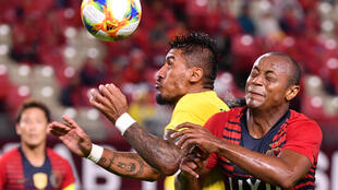 Guangzhou Evergrande's Brazilian midfielder Paulinho is among the players currently unable to enter China