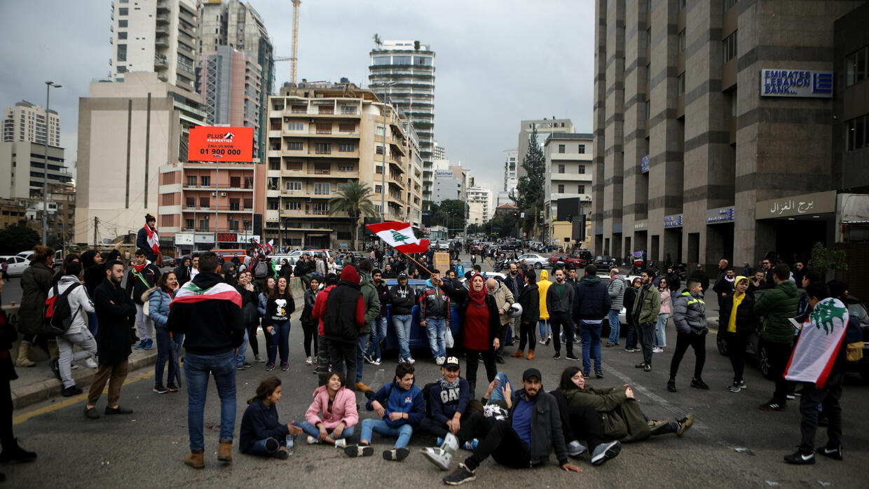 Lebanese block roads as revived protests enter fourth month