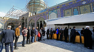 Iranians queue up to vote in parliamentary elections at the Shah Abdul Azim shrine on the southern outskirts of Tehran on February 21, 2020.