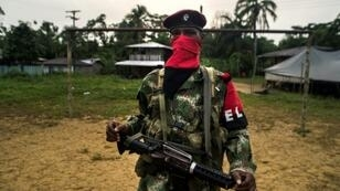 """A member of the """"Omar Gomez"""" Western War Front of the National Liberation Army (ELN) in a camp on the banks of the San Juan River, Choco department, Colombia"""