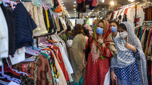 Women shop for clothes ahead of the Eid al-Fitr holiday in the Pakistani city of Karachi