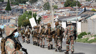 Soldiers patrol the streets in an attempt to enforce a 21 day nationwide lockdown, aimed at limiting the spread of coronavirus disease (COVID-19), in Alexandra township, South Africa, March 28, 2020.