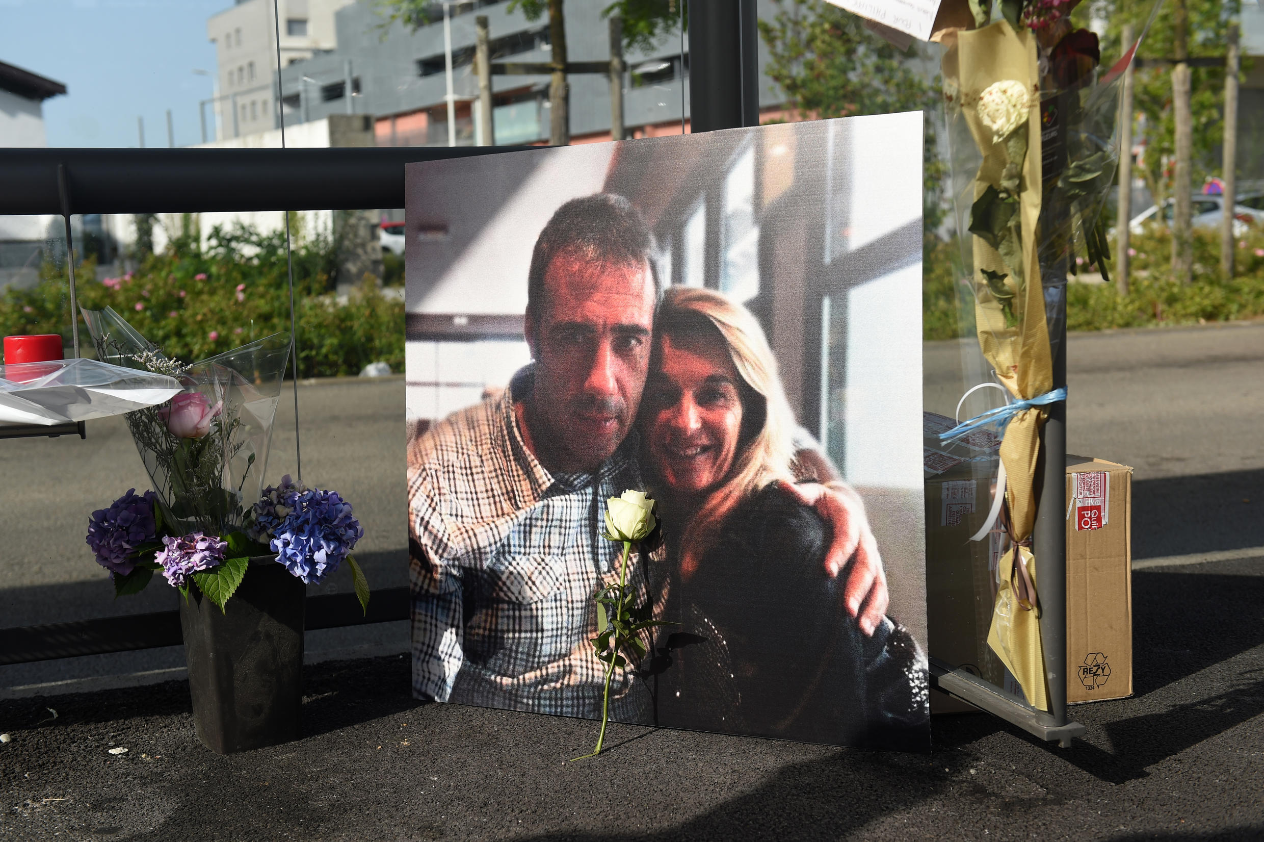 A picture of Veronique Monguillot and Philippe Monguillot, a bus driver declared brain dead after being attacked for refusing to let aboard a group of people who were not wearing face masks, is displayed during a white march in Bayonne, southwestern France, on July 8, 2020.