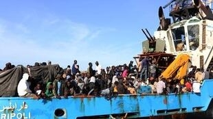 A Libyan coastguard boat carrying around 500 mostly African migrants arrive at the port in the city of Misrata on May 3.