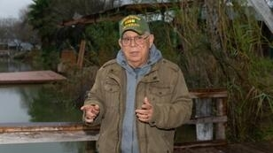"""Reynaldo Anzaldua speaks on his family's property in Mission, Texas, on January 15, 2019. After all, who would want to come spend a relaxing weekend staring at a giant concrete wall, or even towering steel slats? Would tenants even be allowed to cross back and forth? """"It's an unknown to us,"""" says Rey Anzaldua, a cousin of the Cavazos siblings and Fred's best friend."""
