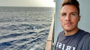 """Ryan Driscoll, 26, says he is enduring a lot of """"stress and anxiety"""" while stuck aboard the Seabourn Odyssey, anchored off Barbados -- he has been at sea for nearly three months"""