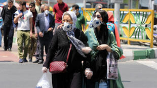 Iranian women wearing protective masks amid the novel coronavirus pandemic, in the capital Tehran