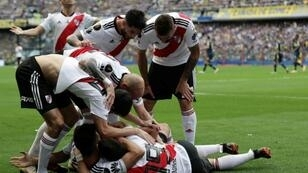 River Plate players celebrate an own goal by Boca Juniors' Carlos Izquierdoz as the Copa Libertadores final 1st leg finishes in a 2-2 draw