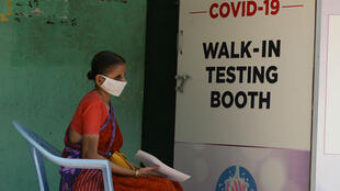 A women waits at a Covid-19 testing centre in Chennai on June 26, 2020.