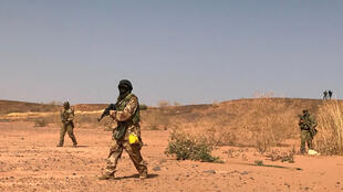 Nigerien commandos simulate a raid on a militant camp during the US-sponsored Flintlock exercises in Ouallam, Niger on April 18, 2018.
