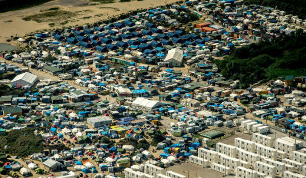 "This picture taken on August 16, 2016, in Calais, shows an aerial view of the ""jungle"" camp, which at its height housed almost 10,000 people."