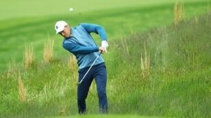 Three-time major winner Jordan Spieth chips onto the fifth green during a practice round for the PGA Championship, which begins Thursday at Bethpage Black
