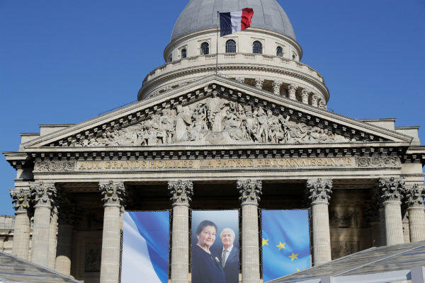 Images of Simone Veil and her husband Antoine hang at the Panthéon in Paris ahead of their burial on Sunday.