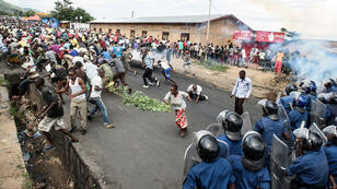 Burundi's policemen and army forces face protestors during a demonstration against incumbent president Pierre Nkurunziza's bid for a 3rd term on 13 May 2015 in Bujumbura.