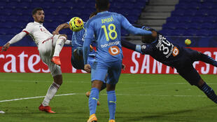 Houssem Aouar (L) has what he thought was his winning goal ruled out for a foul on Marseille keeper Steve Mandanda