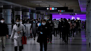 People wearing face masks are seen at a subway station as the country is hit by an outbreak of the novel coronavirus, in Shanghai, China, March 2, 2020.