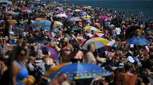 File photo of beachgoers in Britain