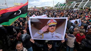 Supporters of East Libya's strongman Khalifa Haftar gather in Benghazi on January 3, 2020.