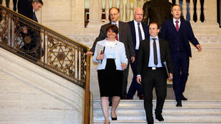 Northern Ireland's Democratic Unionist Party (DUP) leader Arlene Foster (C), with party colleagues, make their way into the Northern Ireland Assembly at the Parliament Buildings on the Stormont Estate in Belfast on January 11, 2020.