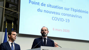 French Prime Minister Édouard Philippe (R) and Health Minister Olivier Véran give a press conference following a ministers meeting on the COVID-19 outbreak caused by the coronavirus, on March 6, 2020, in Paris.