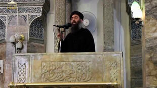 Abu Bakr al-Baghdadi delivers a speech at the Grand Mosque al-Nuri in June 2014.