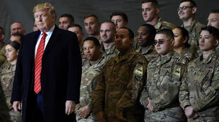US President Donald Trump speaks in November 2019 to US troops at Bagram Air Field in Afghanistan,from which he is ordering a withdrawal of forces