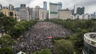 Des manifestants se rassemblent à Victoria Park pour exiger des réformes politiques à Hong Kong, le 18août2019.