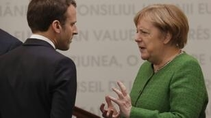 """""""We always find a middle way,"""" said German Chancellor Angela Merkel (R) on her political relationship with French President Emmanuel Macron"""