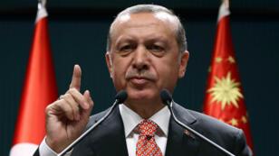 """Le président turc a annoncé que la purge allait se poursuivre jusqu'à """"l'éradication du virus""""."""