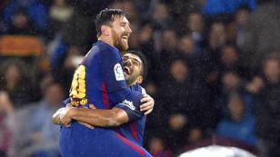 Le duo d'attaquants du FC Barcelone, Lionel Messi et Luis Suarez.