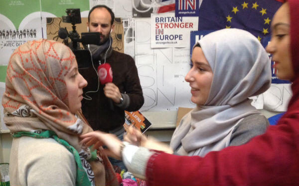 "A Sciences Po student tries on a Muslim veil during ""Hijab Day"" at the prestigious university in central Paris on April 20, 2016."