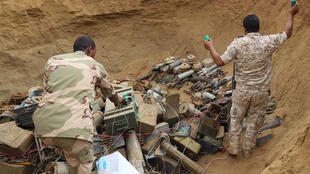 Saudi-backed Sudanese and Yemeni military experts deactivate landmines allegedly placed by Huthi rebels in January 2021in Yemen's northern coastal town of Midi
